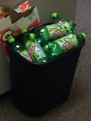 Picture of Mountain Dew in a garbage can.