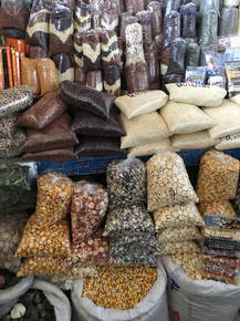 Photo of quinoa and corn for sale.